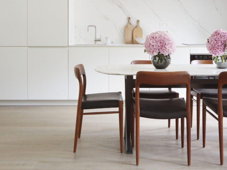 white dining table with dark wood chairs