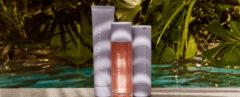 three Fenty Skin skincare products near tropical plants
