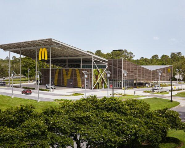 a wide shot of a McDonald's restaurant with a sloped, v-shaped roof. a yellow