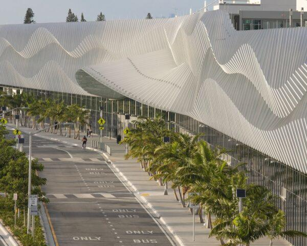 convention center building with large metal exterior with a wavy pattern