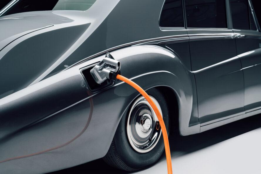 electric charger plugged into gray Rolls-Royce