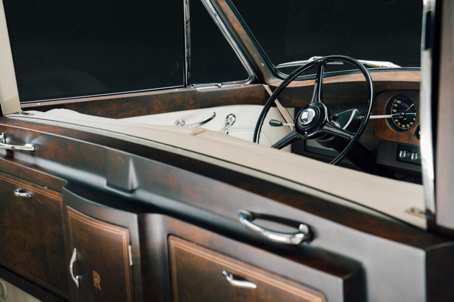 dark wood and cream leather interiors of a Rolls-Royce