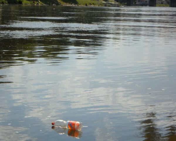plastic bottle floating down a river