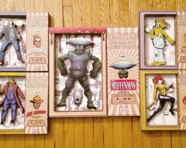 cardboard figurines in cardboard boxes