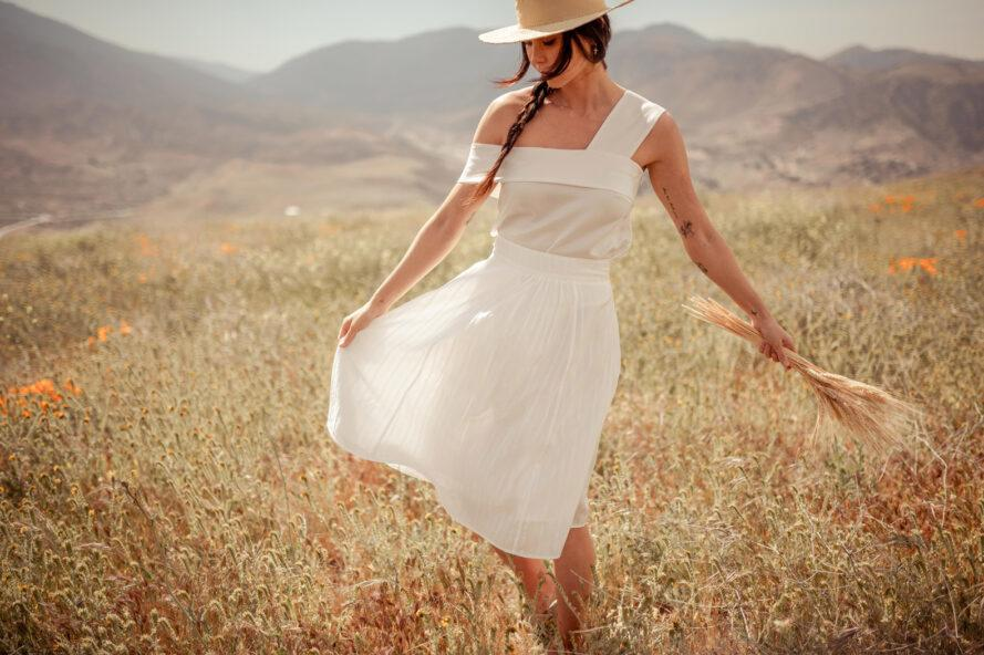 person twirling in white dress