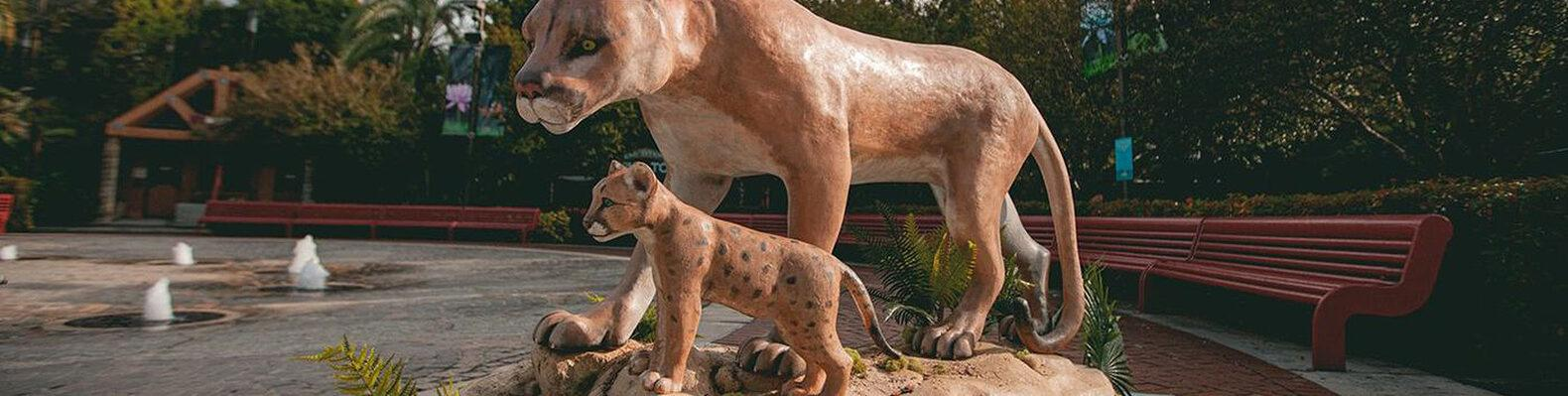 wax sculpture of Florida panther and panther cub