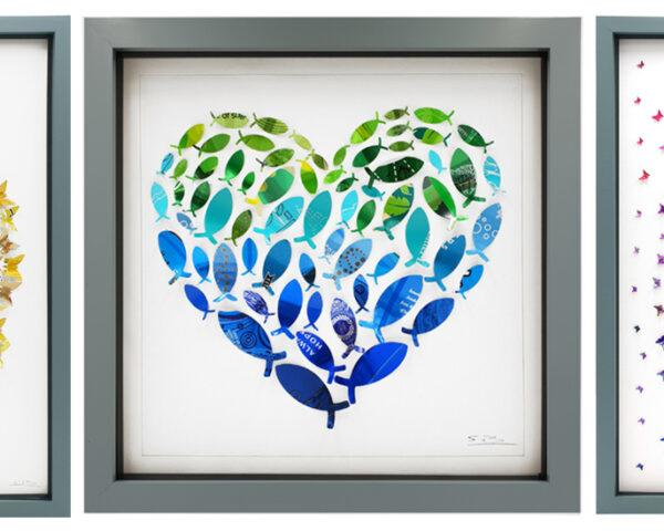 three framed artworks in the shape of a tree, a heart and a circle