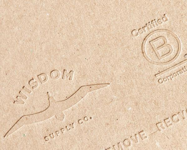 cardboard planner embossed with Wisdom Supply Co. and Certified B-Corp logos