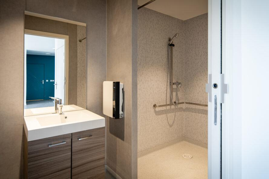 tan bathroom with accessible shower