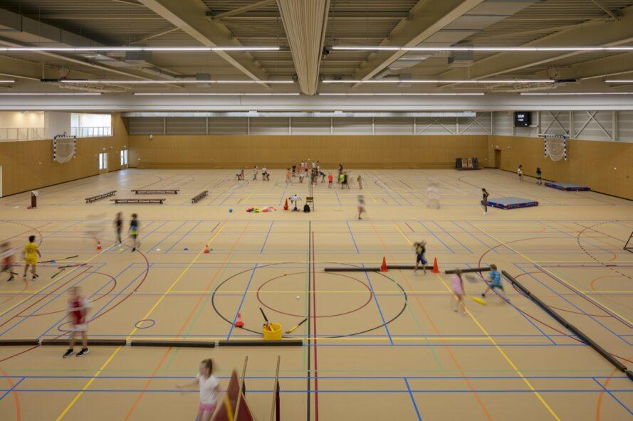 people playing in a sports hall