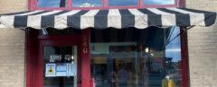 red radio station storefront with black-and-white striped awning