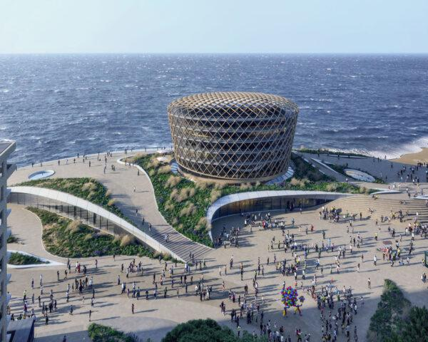 aerial rendering of round glass building by the sea