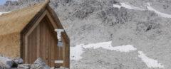 reed hut on snowy mountainside