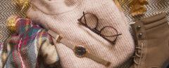 pink sweater, brown glasses, gold watch, brown boots and plaid scarf flat lay