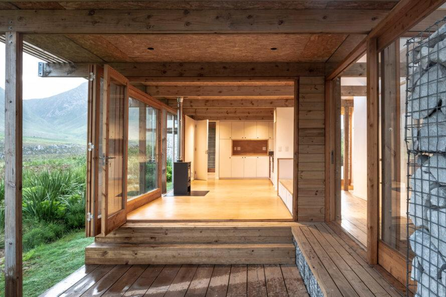 wood cabin with glass door opening to the inside