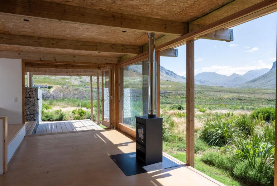 covered wood deck facing mountainous landscape