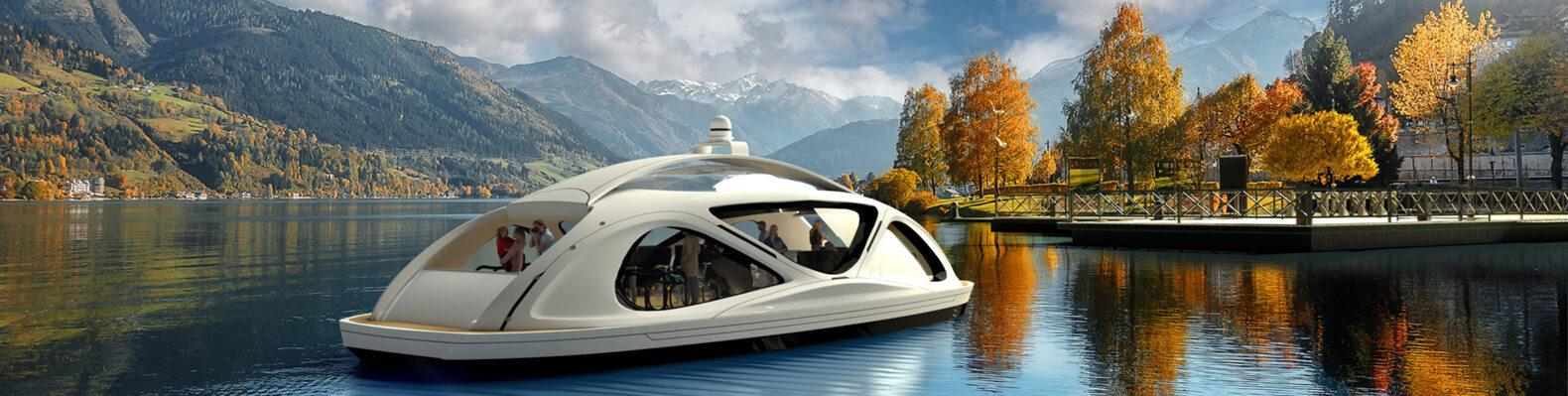 white pod-like ferry on water with autumnal trees and snow-capped mountains in the background