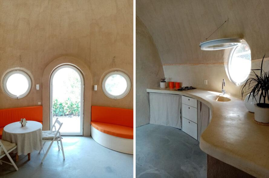 orange built-in seats and curving wood counters inside dome home