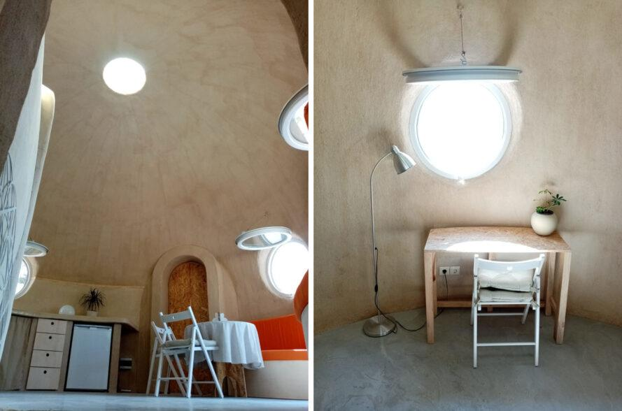 orange seats and wood desk in dome home with round windows