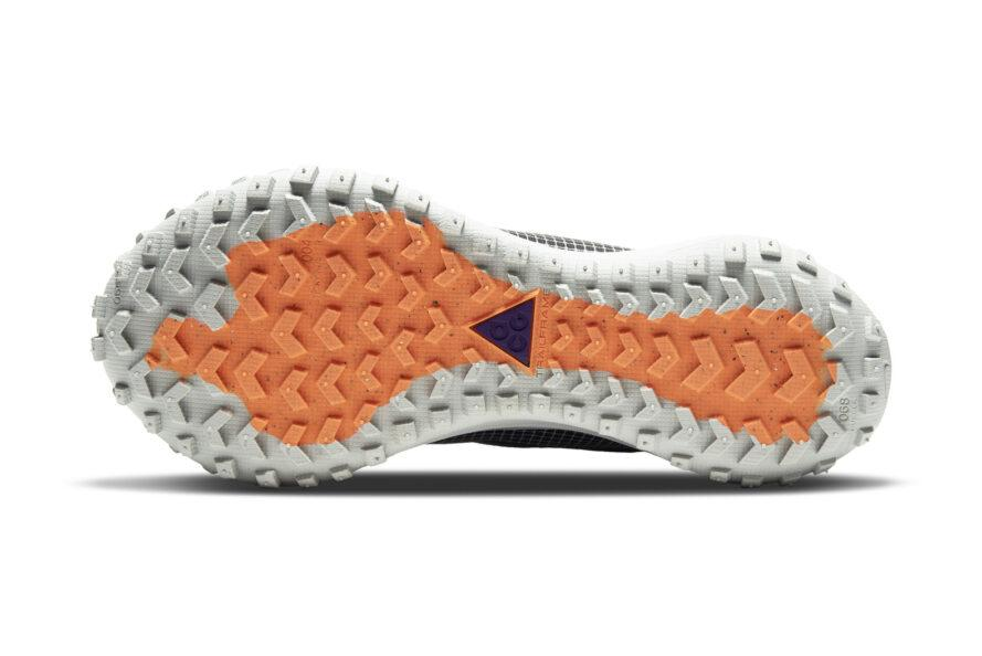 The white and orange tread of a pair of Nike ACG Air Mountain Fly Gore-Tex shoes.
