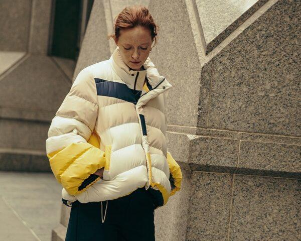 person wearing puffer jacket with multiple colors