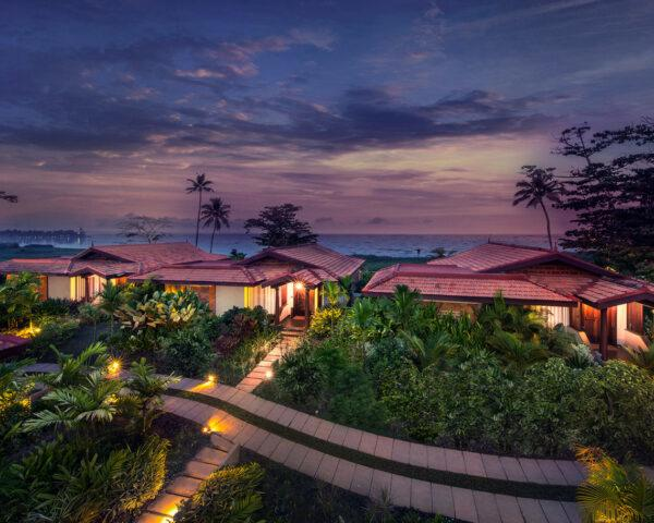 aerial view of tropical hotel resort at sunset