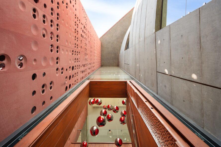 skylight between red clay and concrete walls