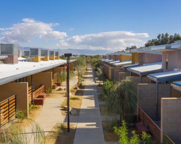 rows of tan and yellow housing complexes