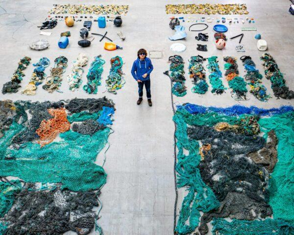 aerial view of Boyan Slat standing among recovered ocean plastic