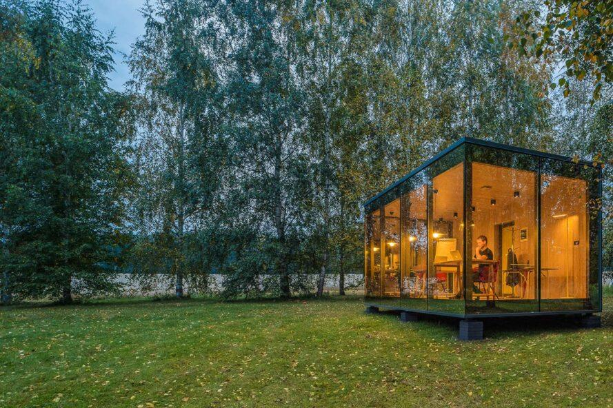 glass cabin in the woods