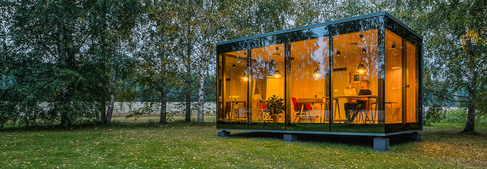 ÖÖD prefab glass cabin immerses you in nature while you work