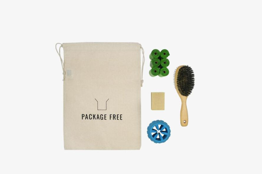 zero-waste kit with dog poop bags, brush, and chew toy