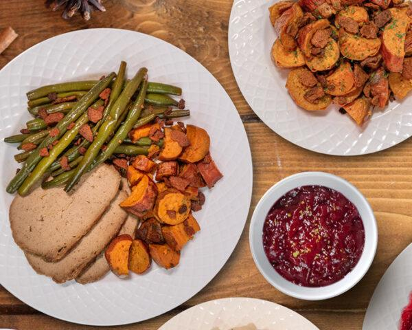 vegan turkey, potatoes and green beans on dinner table