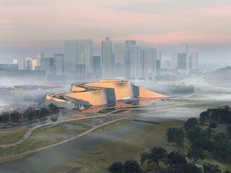 aerial rendering of massive, curving white building with a city skyline on the horizon behind the white building