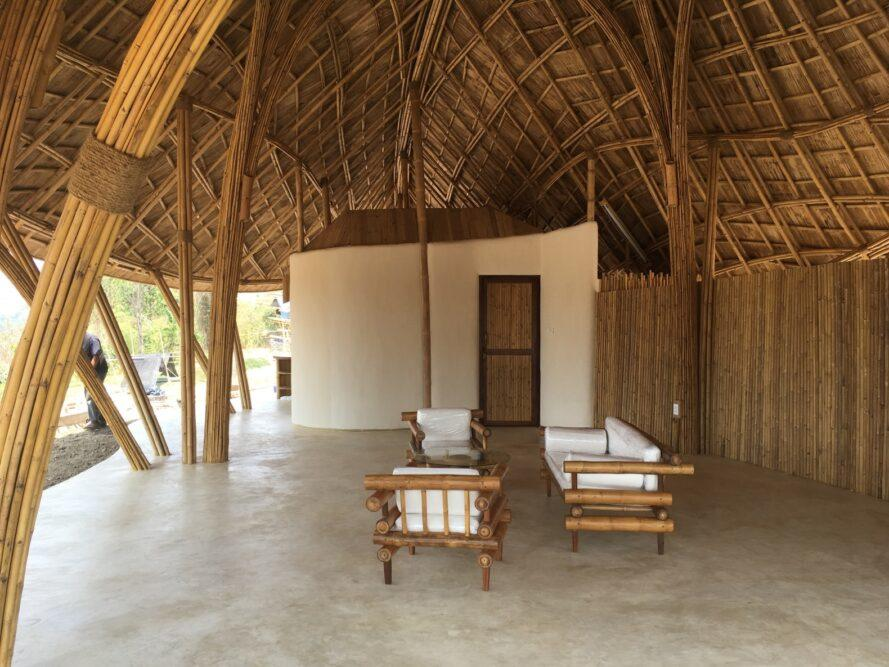 white and bamboo seats under a thatched roof
