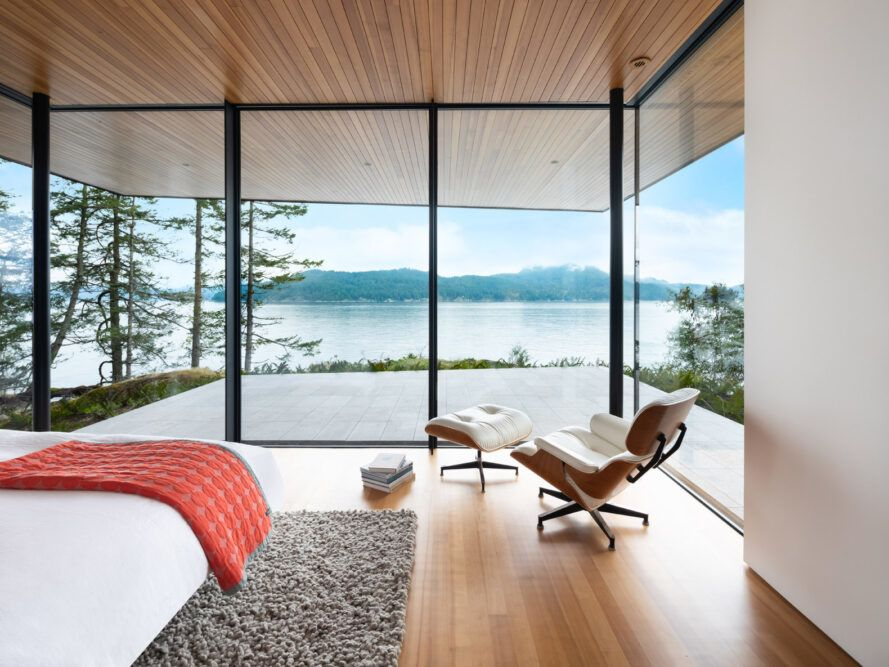 bed and chair facing glass wall