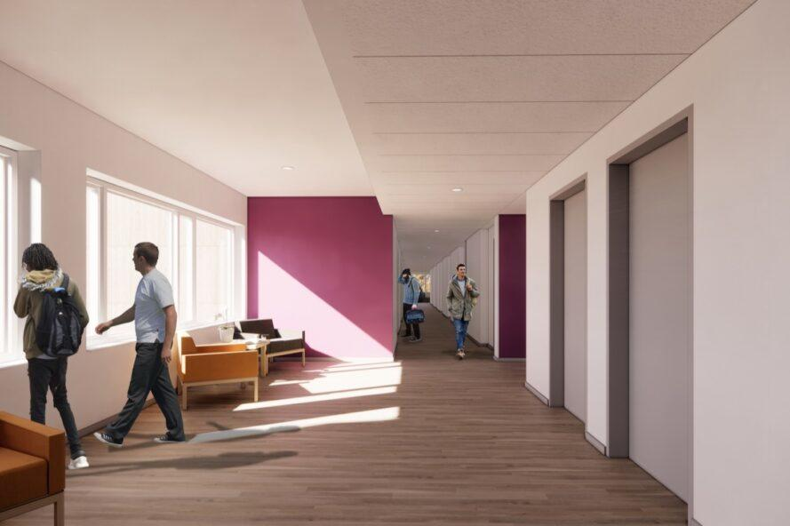 hallway with white and purple walls and lounge chairs