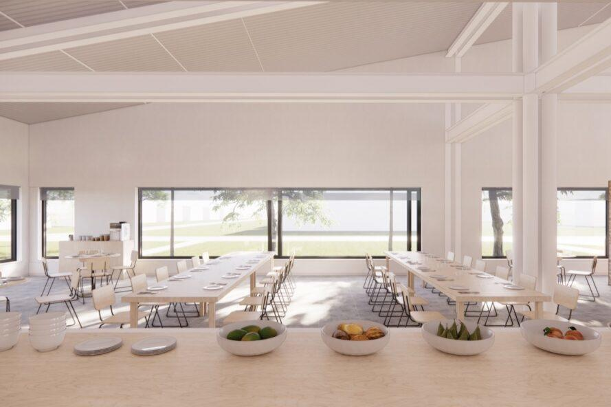 long wood dining tables in a large white room