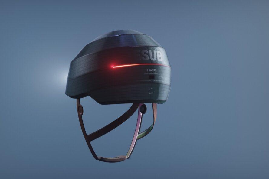"""A black helmet with a red light-up strip and the text """"ESUB"""" written on it."""