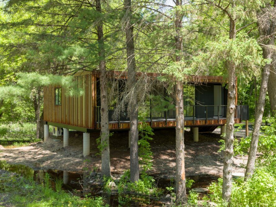weathered steel prefab home with glazed end wall