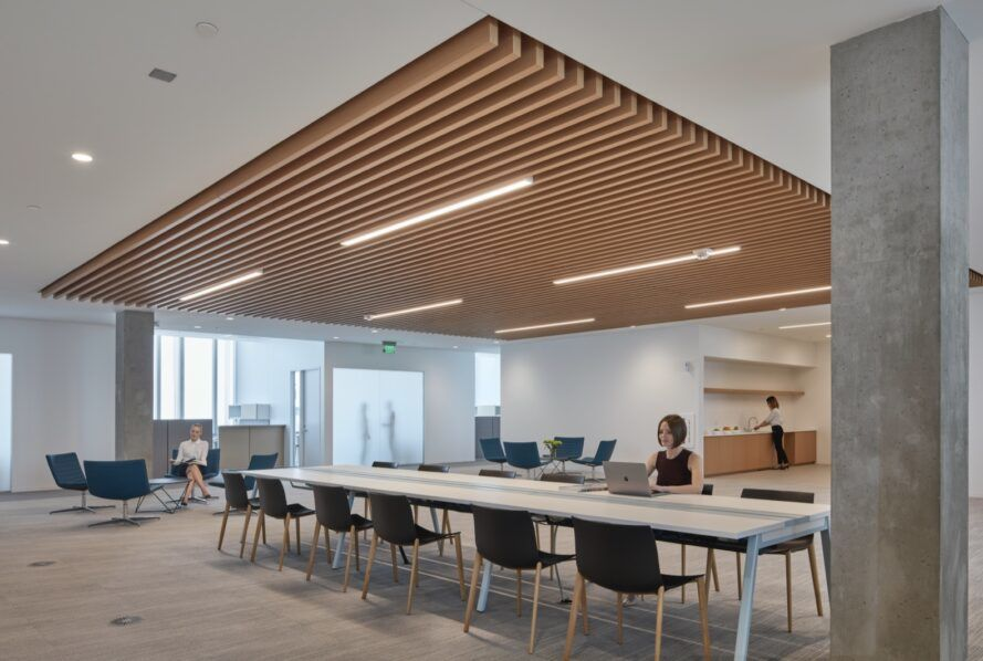 long meeting tables under timber ceiling