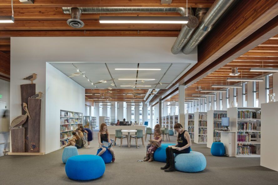 people sitting in blue pouf chairs