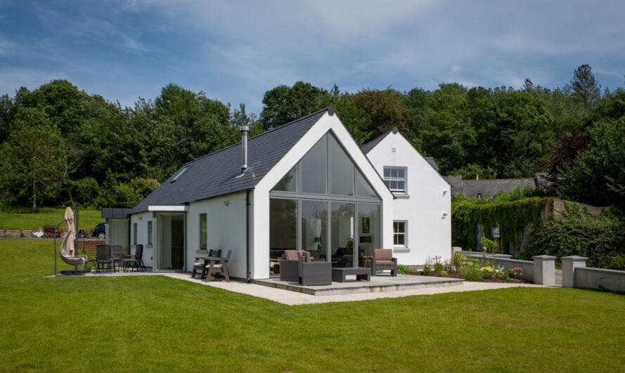 white gabled home with glass end wall