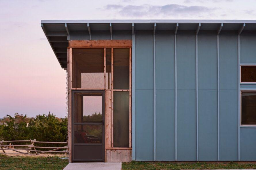 gray tiny home with screened-in front porch