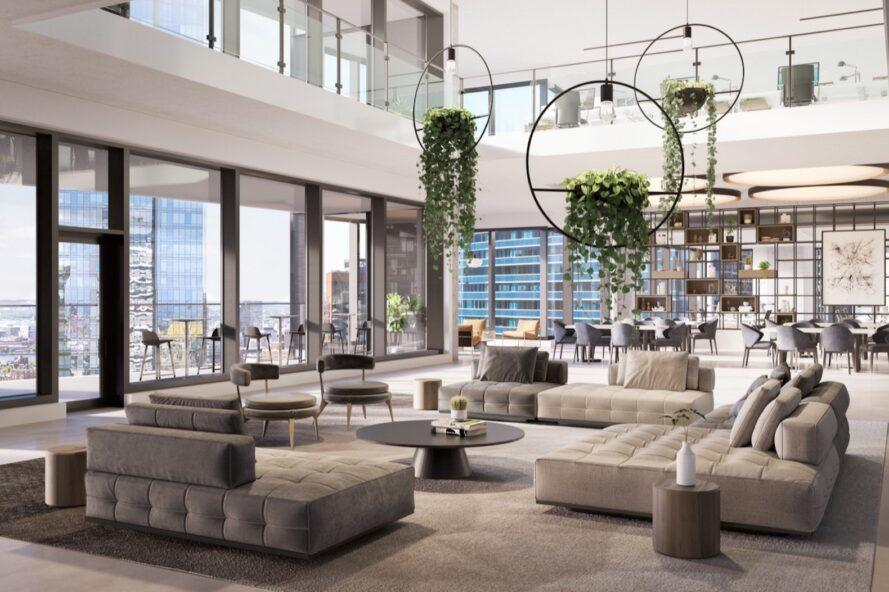 rendering of community living room with large gray sofas and hanging plants