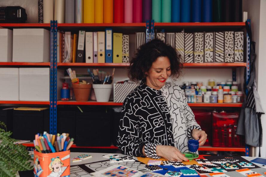 photo of Camille Walala smiling in a colorful art studio