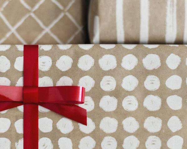 presents wrapped in brown and white paper with red bow