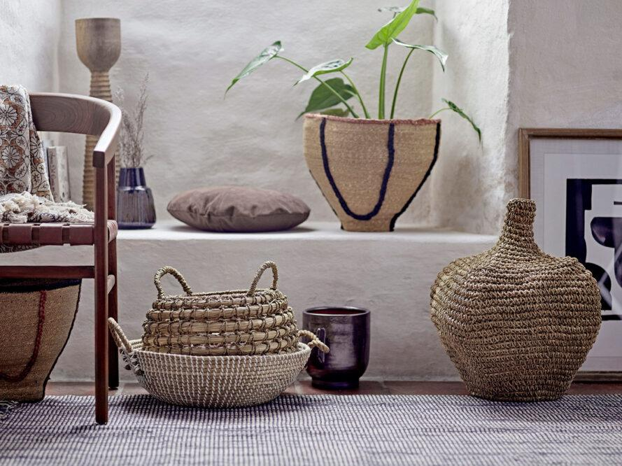 woven baskets with plants inside