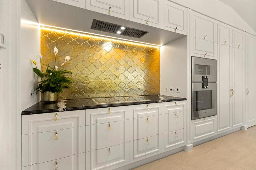 white and gold kitchen with energy-efficient appliances