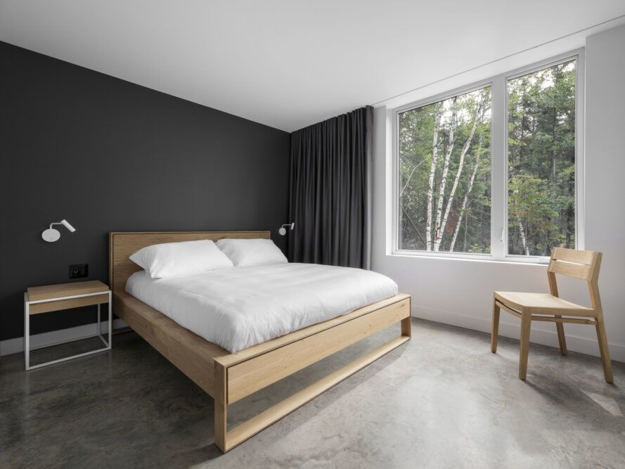 light wood bed in a gray and white room